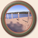 porthole image of beach