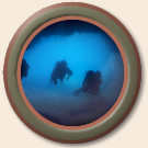 porthole image of divers at the grotto