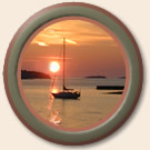 porthole image of sunset